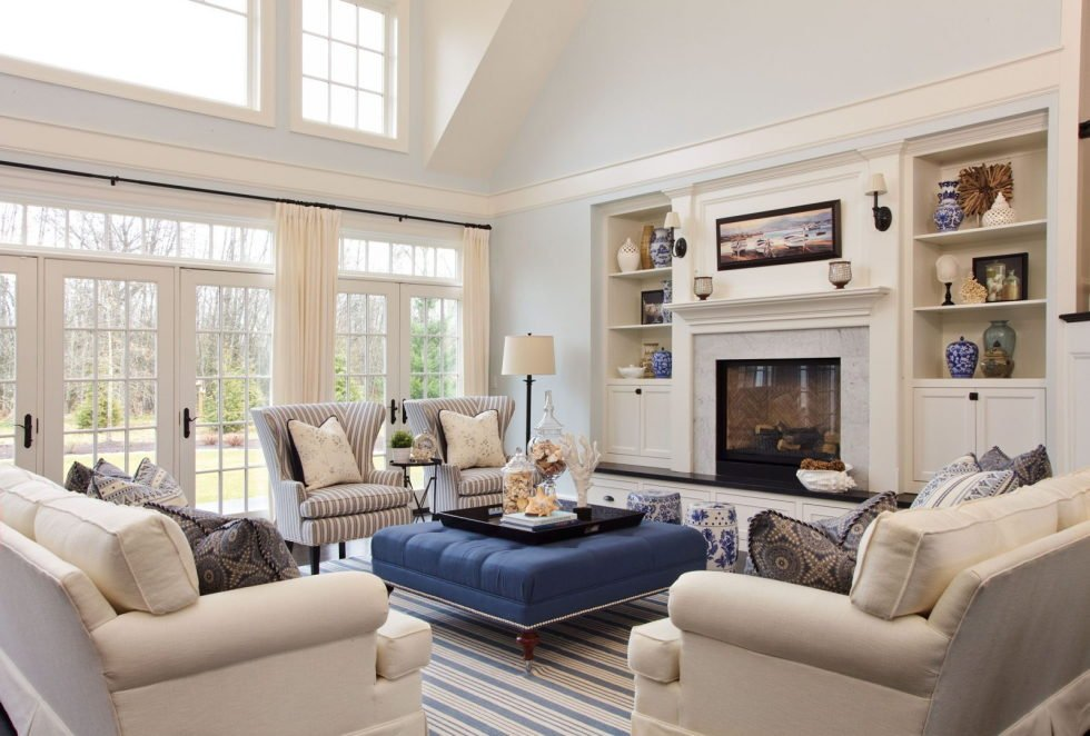 A navy blue ottoman within a beige living room